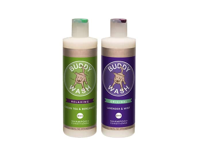 Two Bottles, One Green and One Purple, with Screw on Tops that Encase Goldendoodle Safe Shampoo and Conditioner